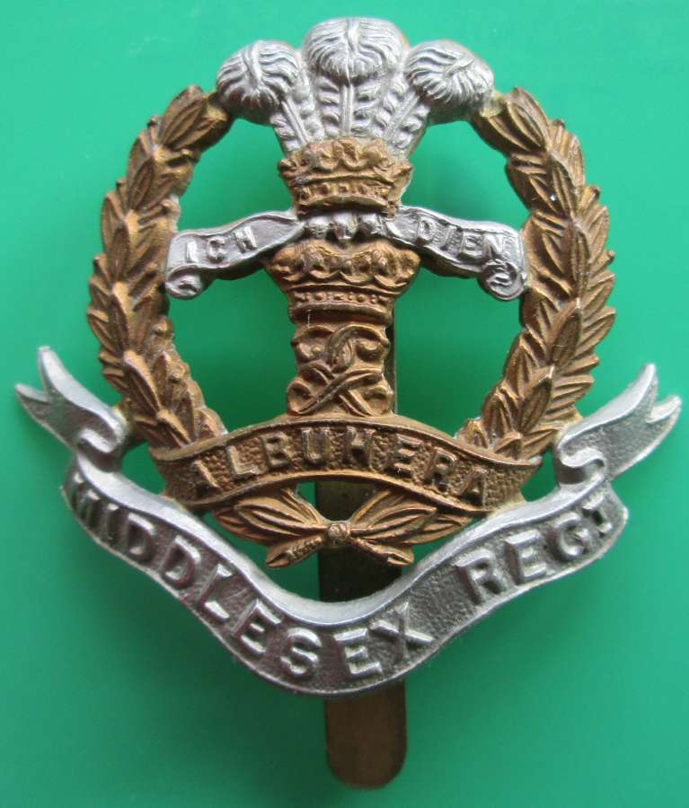 A GOOD MIDDLESEX REGIMENT CAP BADGE