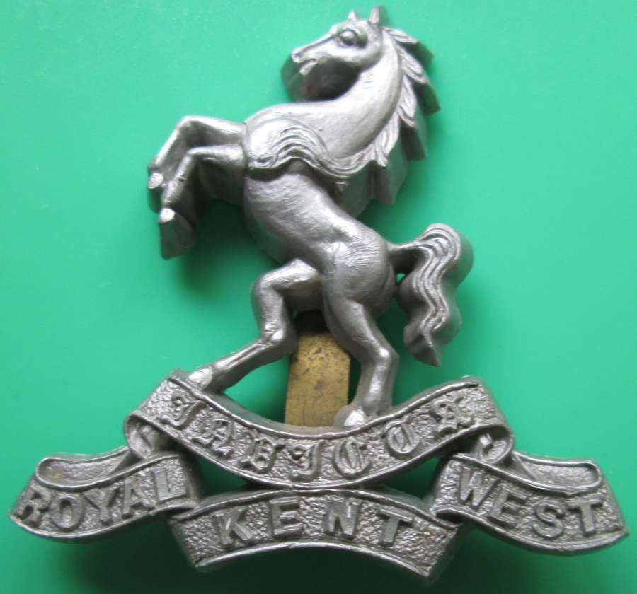 A WWII PERIOD ROYAL WEST KENT PLASTIC ECONOMY CAP BADGE