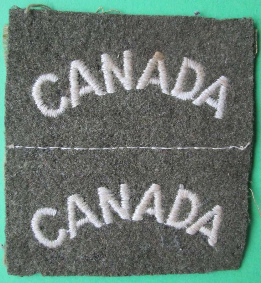 A GOOD UNCUT PAIR OF THE WWII CANADIAN SHOULDER TITLES