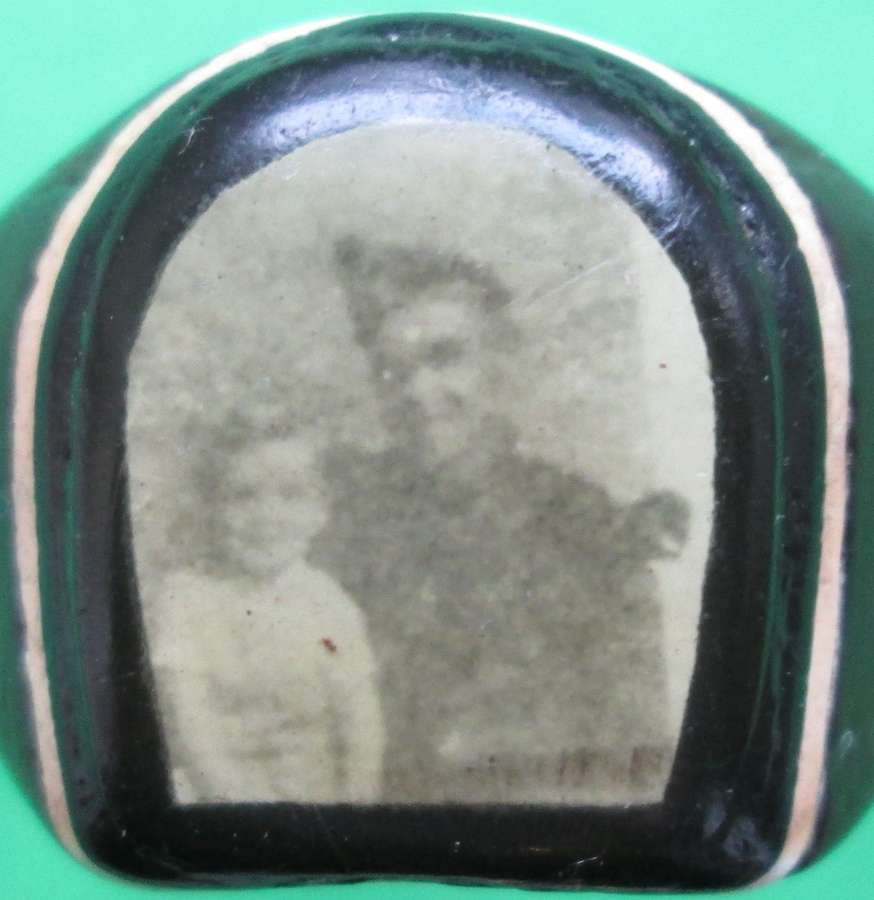 A WOODEN RING WHICH HAS A PHOTO TO THE CENTRE