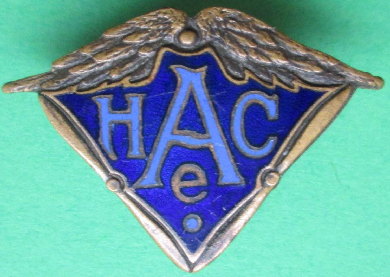 A WWI PERIOD AIRCRAFT MAKERS BADGE H A C E LAPEL FITTING