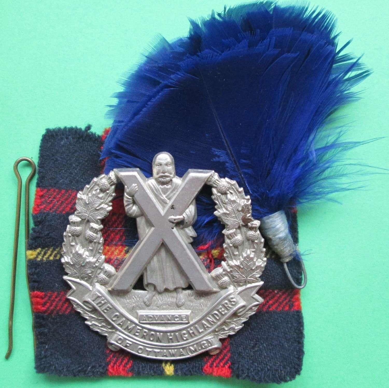 A WWI-WWII PERIOD CAMERON HIGHLANDERS OF OTTAWA ( MG ) GLENGARRY BADGE