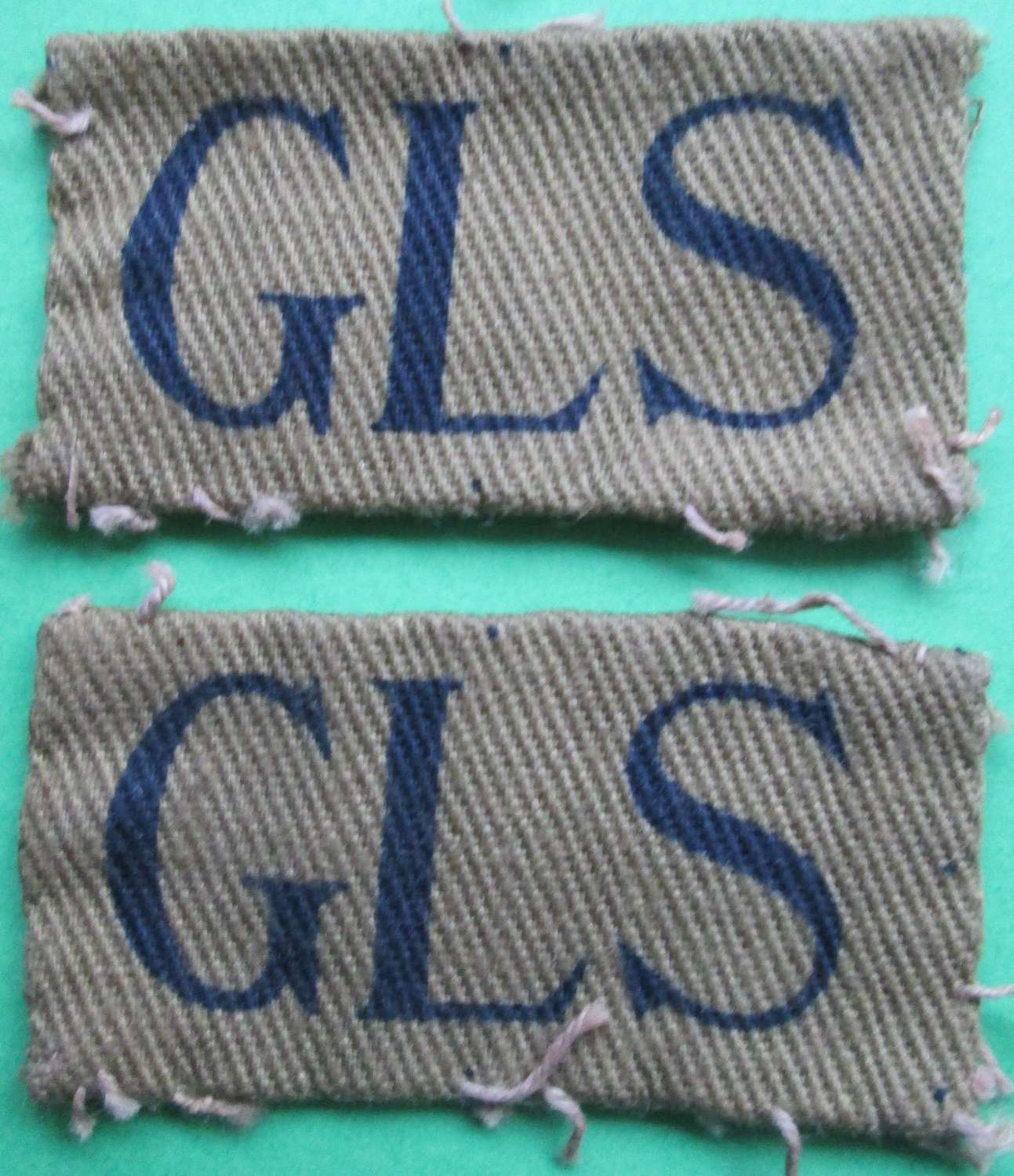 A PAIR OF GLOUCESTERSHIRE HOME GUARD DESIGNATION FLASHES