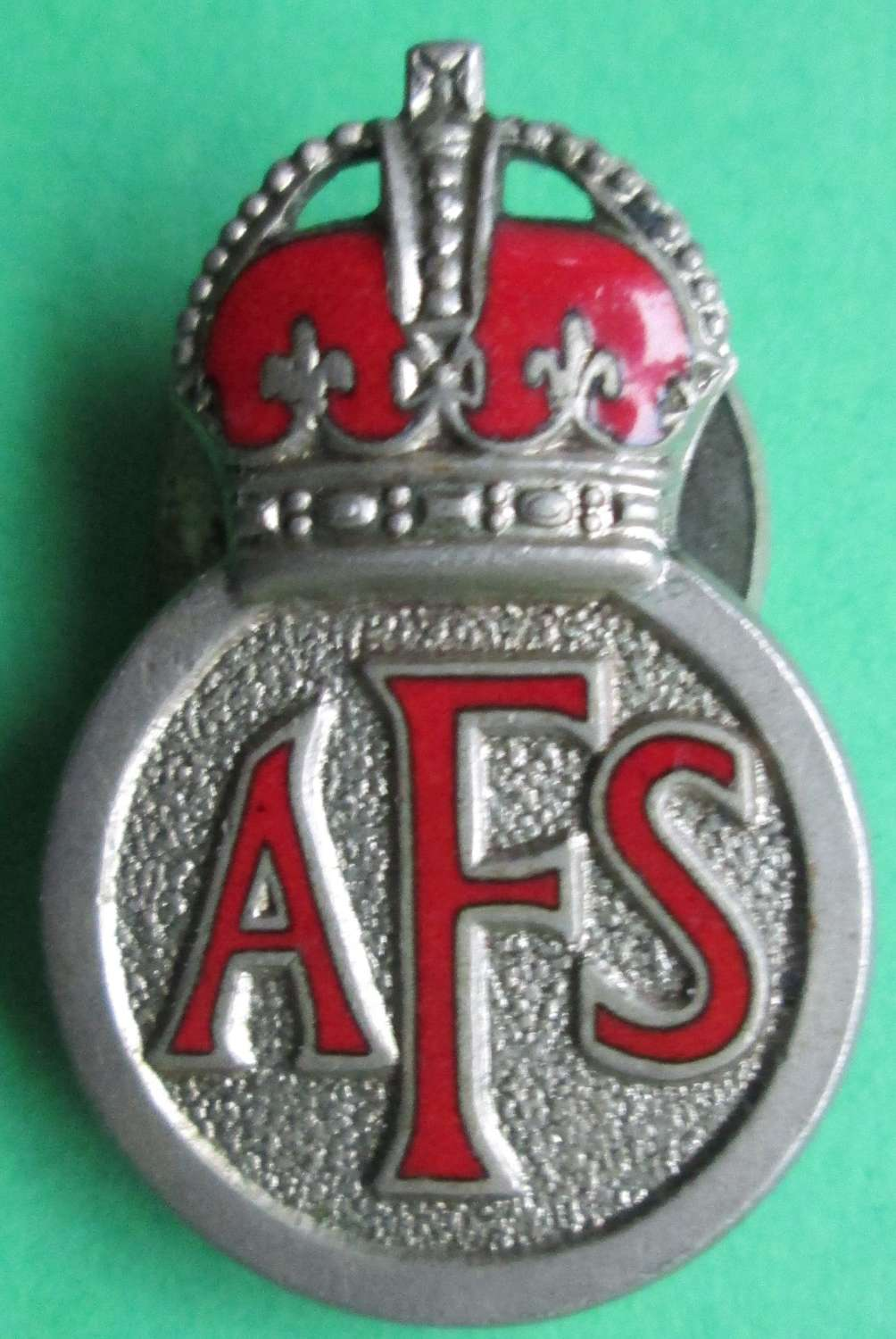 AN AUXILLARY FIRE SERVICE LAPEL BADGE