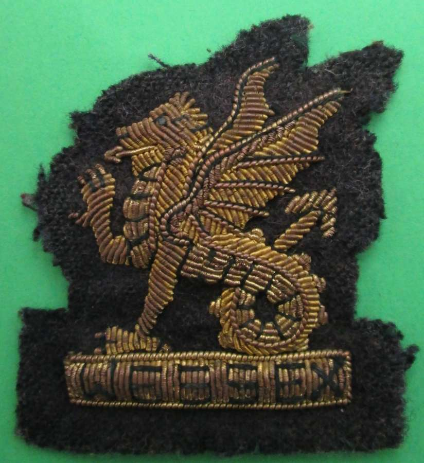 AN OFFICER'S BULLION WIRE BERET BADGE FOR THE WESSEX REGIMENT