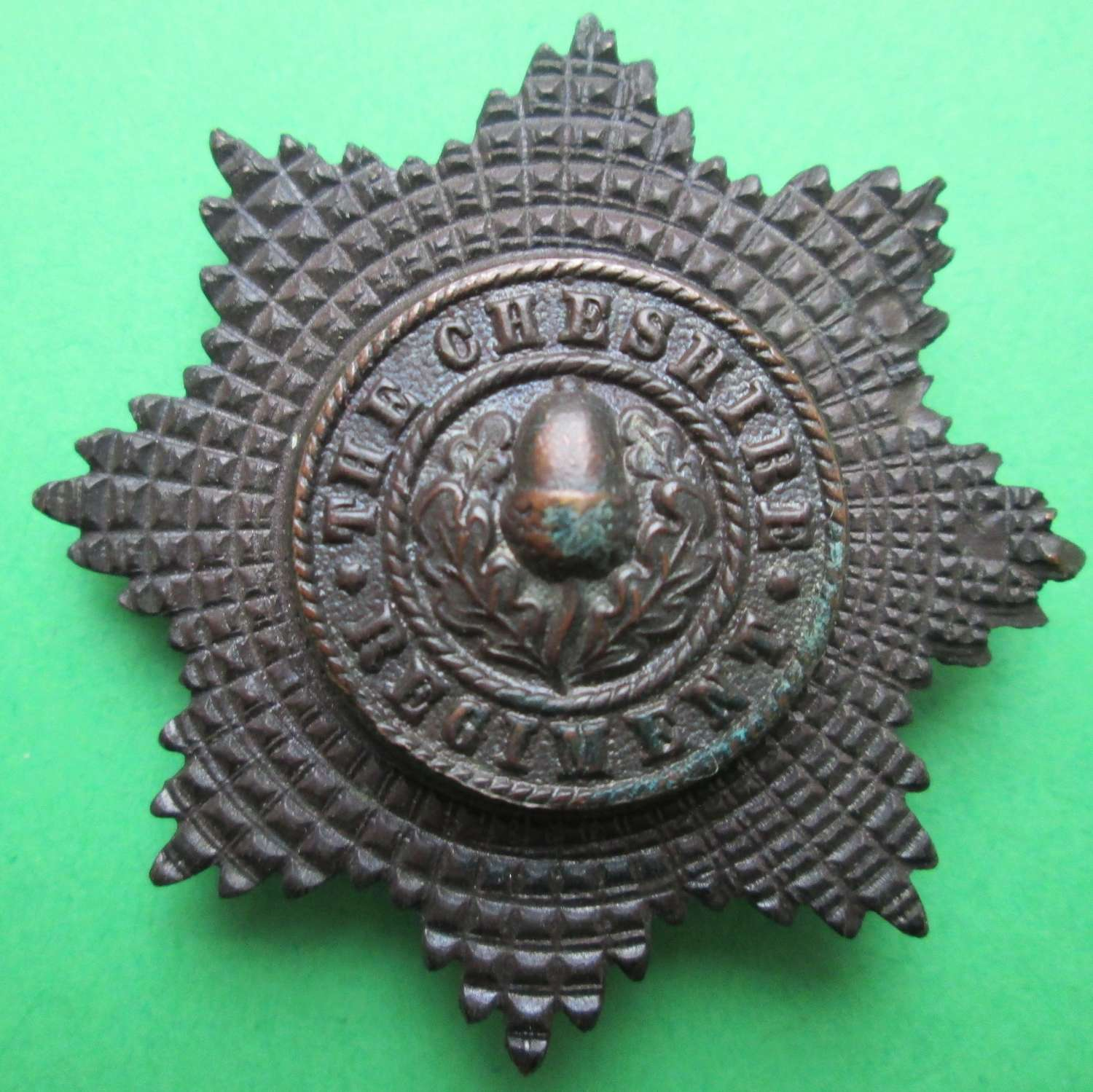 AN OFFICER'S CHESHIRE REGIMENT BADGE