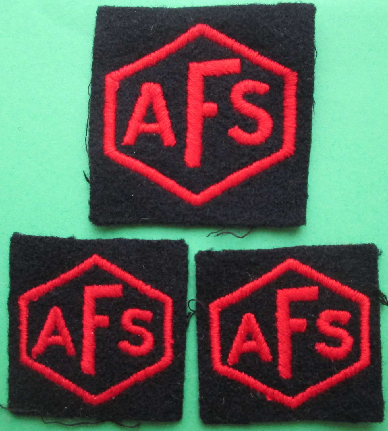 A SET OF AUXILIARY FIRE SERVICE BADGES