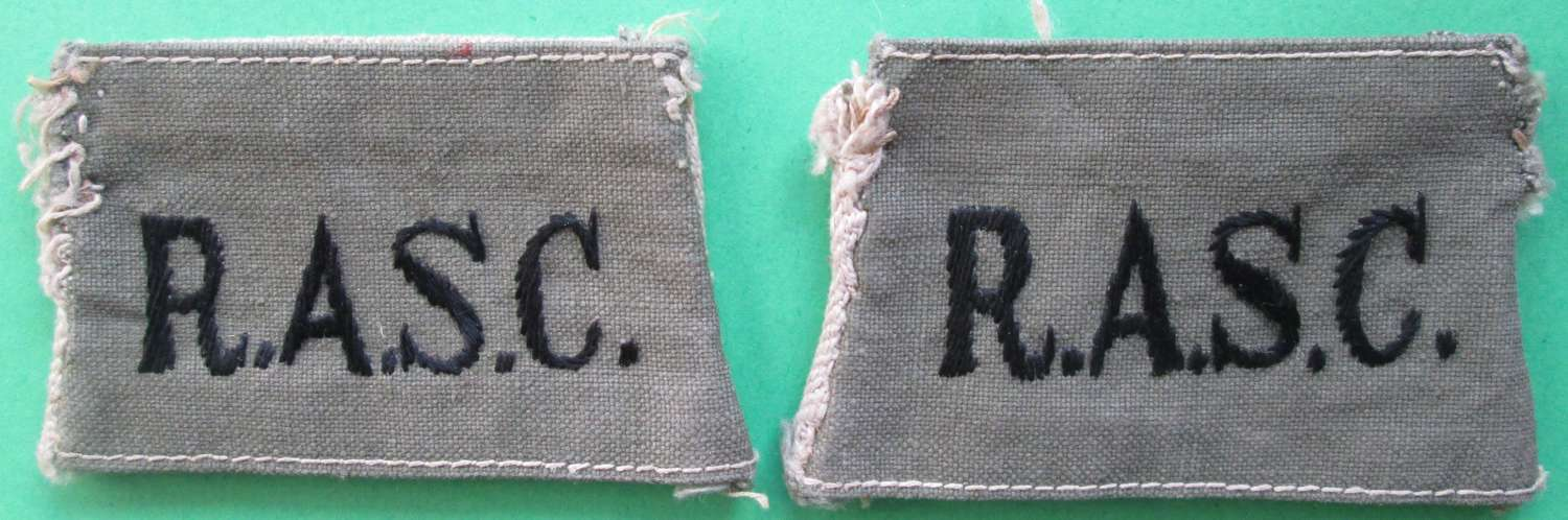 A PAIR OF ROYAL ARMY SERVICE CORPS SLIP ON TITLES