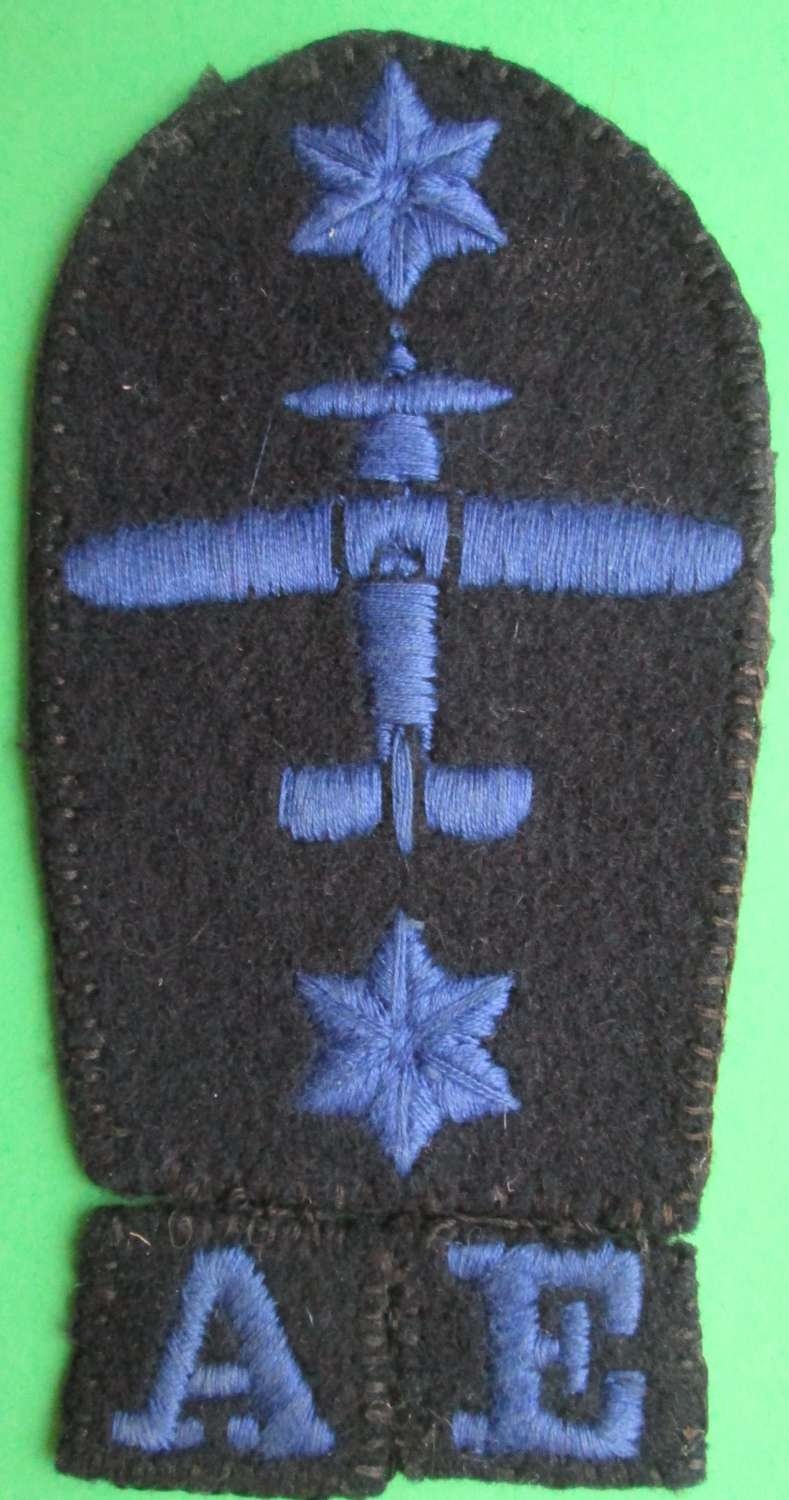 A NAVY WOMENS 'FITTER AND MECHANIC BADGE,2ND CLASS