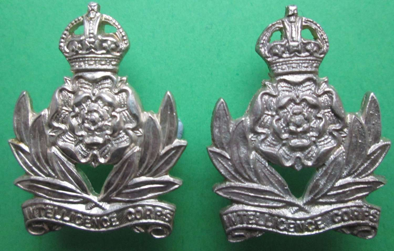 A PAIR OF SILVER INTELLIGENCE CORPS COLLAR DOGS
