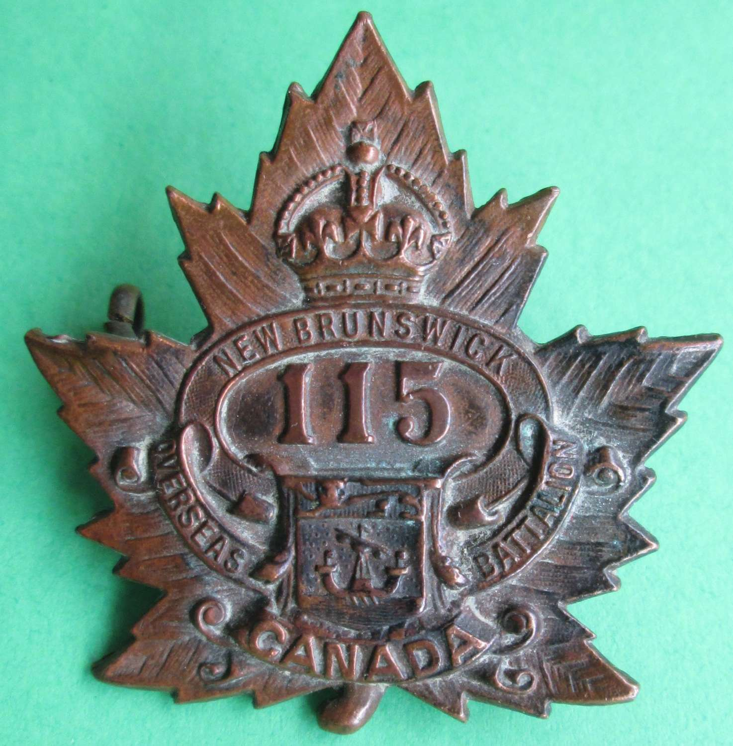 A CANADIAN 115TH INFANTRY BATTALION BADGE
