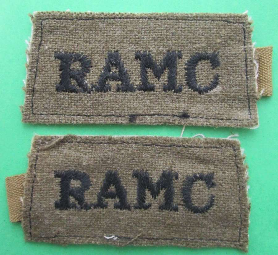 A PAIR OF WWII ROYAL ARMY MEDICAL CORPS SLIP ON TITLES