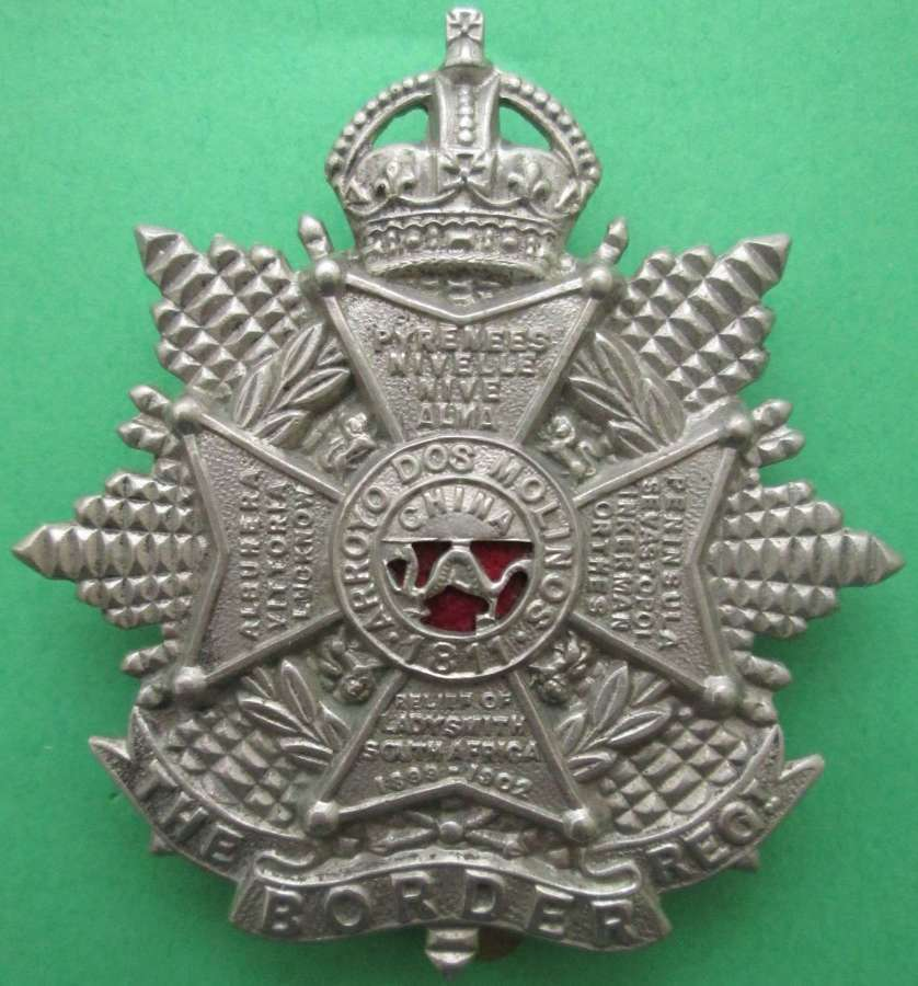 A  WWII PERIOD CAP BADGE FOR THE BORDER REGIMENT