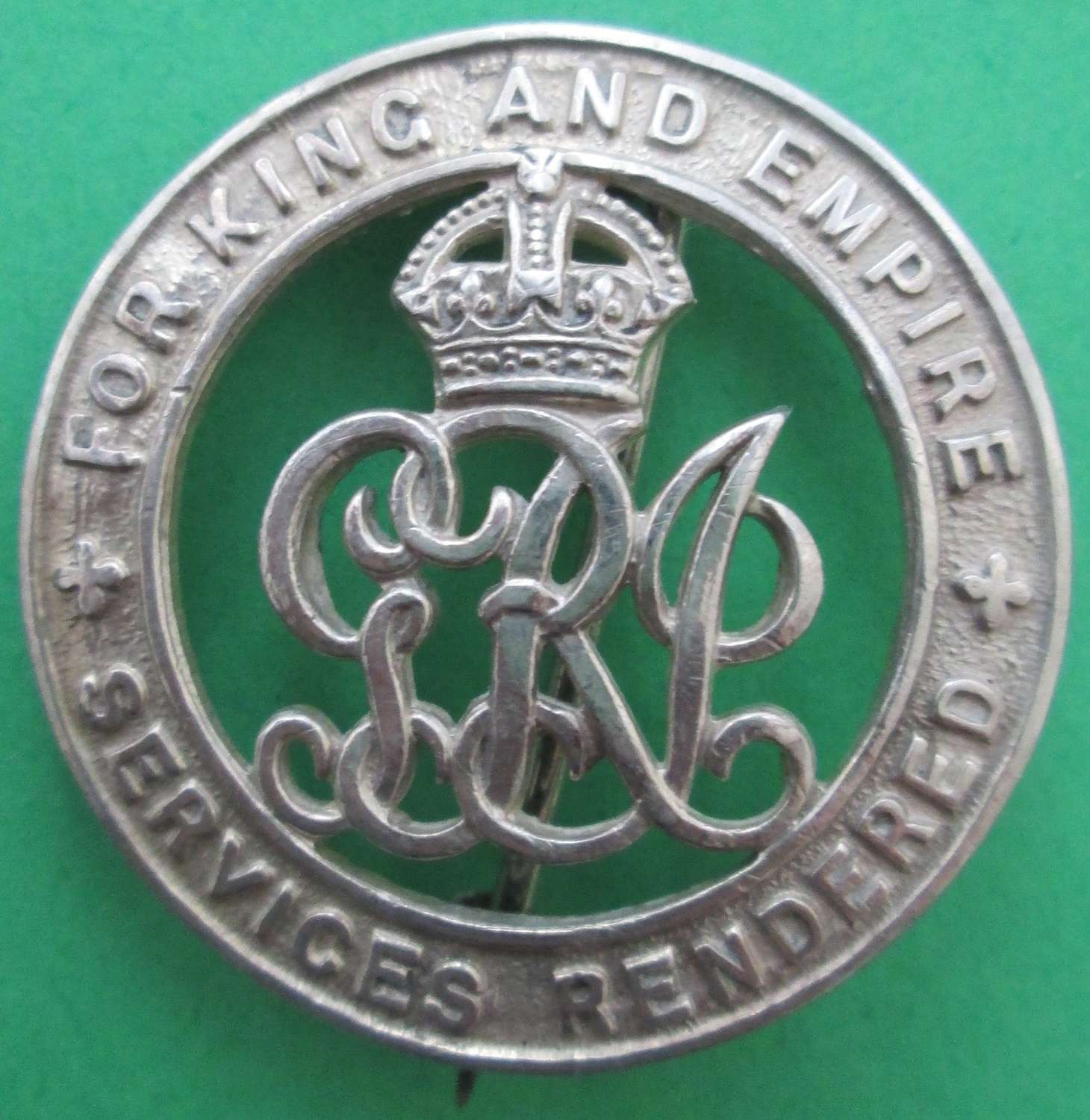 A GOOD WWI SILVER WOUND BADGE