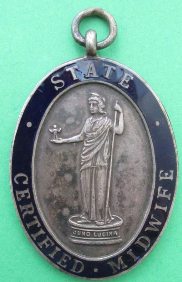 AN OVAL STATE CERTIFIED MIDWIFE'S PENDANT