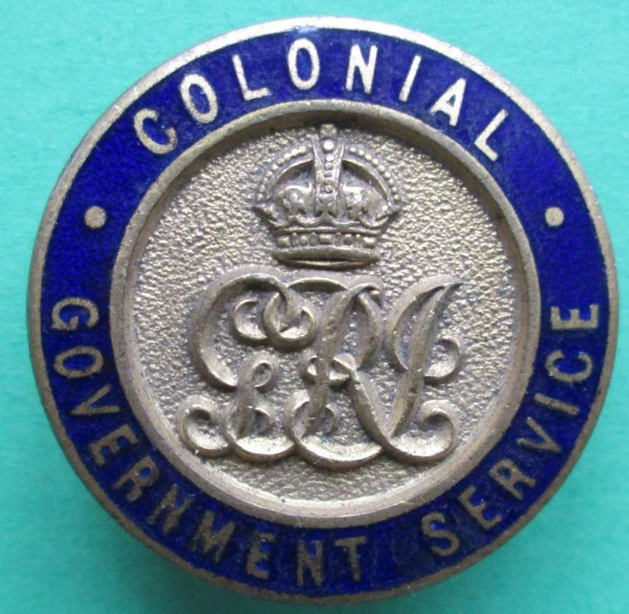 A COLONIAL GOVERNMENT SERVICE LAPEL BADGE