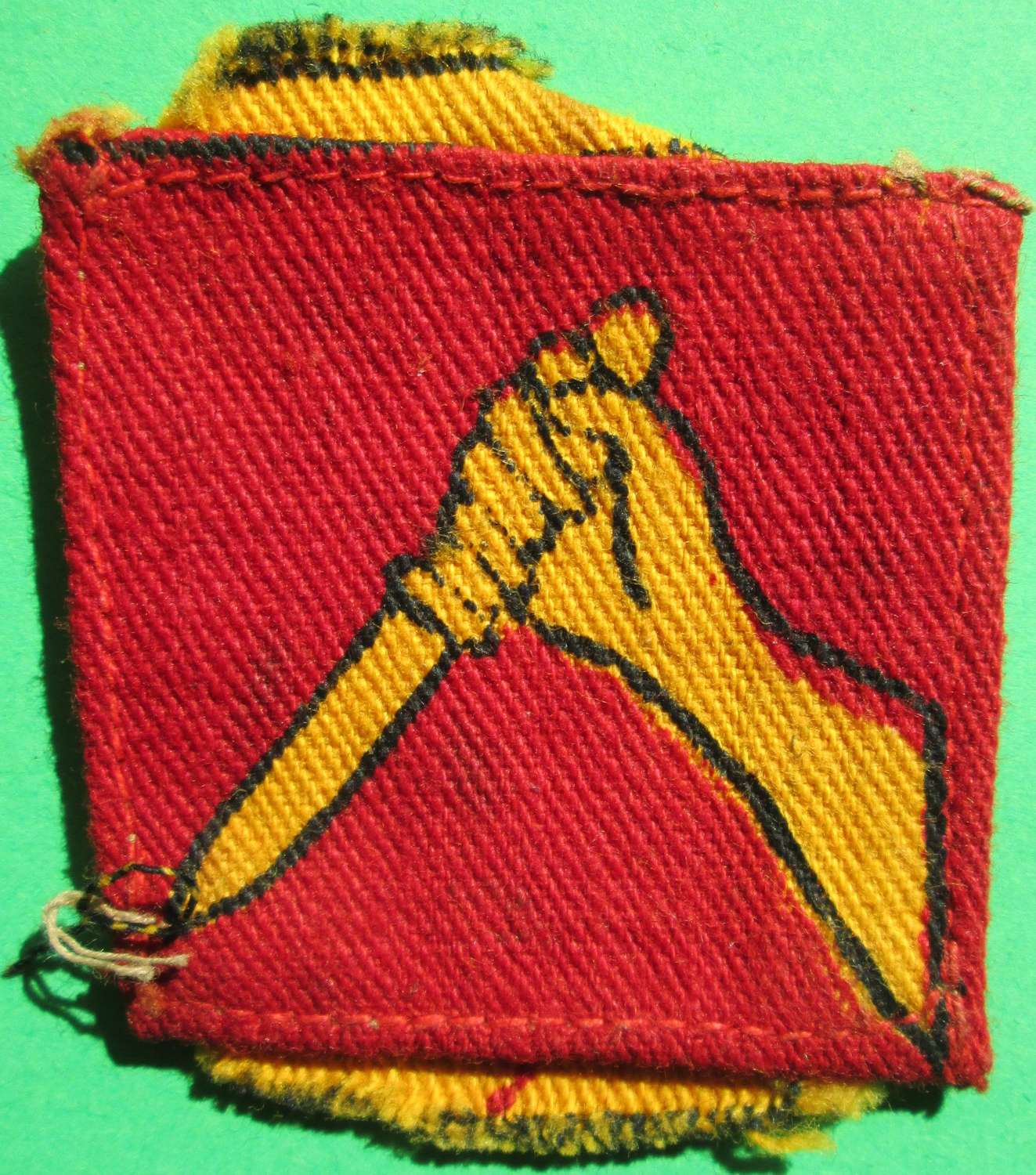A 19TH INDIAN DIVISION PRINTED FORMATION SIGN