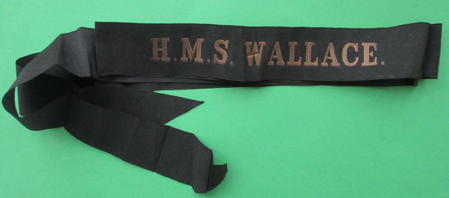 A NICE UNCUT FULL LENGTH CAP TALLY FOR THE HMS WALLACE