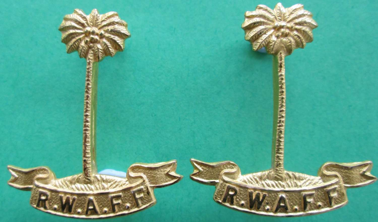 A PAIR OF ROYAL WEST AFRICAN FRONTIER FORCES COLLAR DOGS
