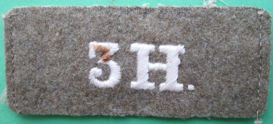 A WWI PERIOD 3RD HUSSARS SLIP ON SHOULDER TITLE