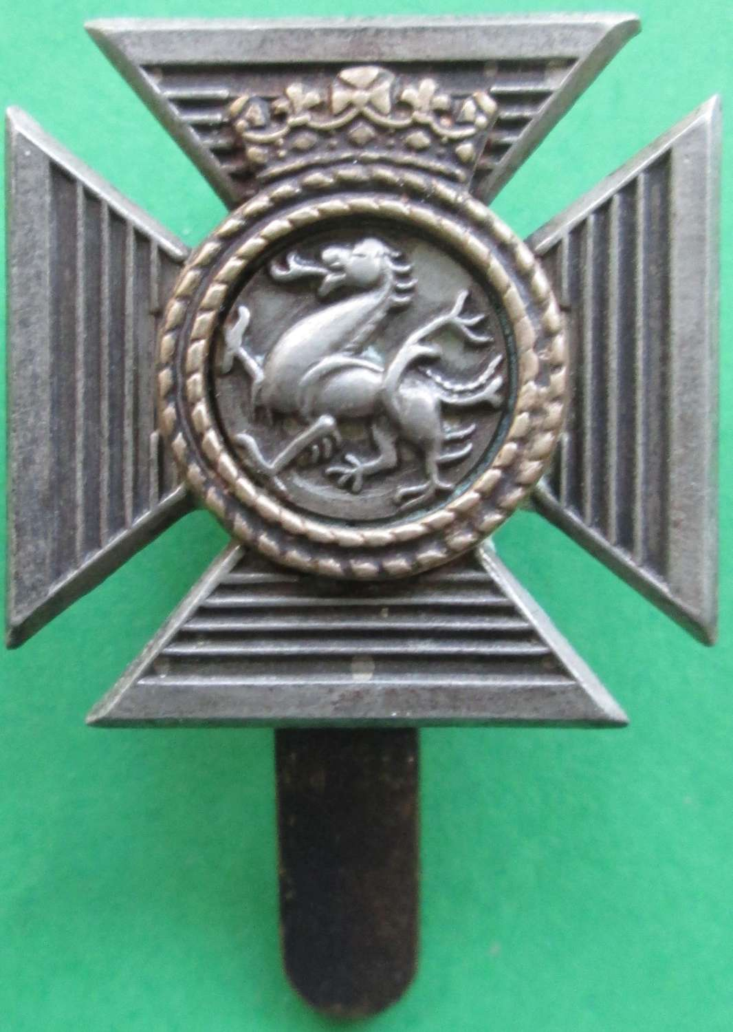 A DUKE OF EDINBURGHS ROYAL REGT CAP BADGE