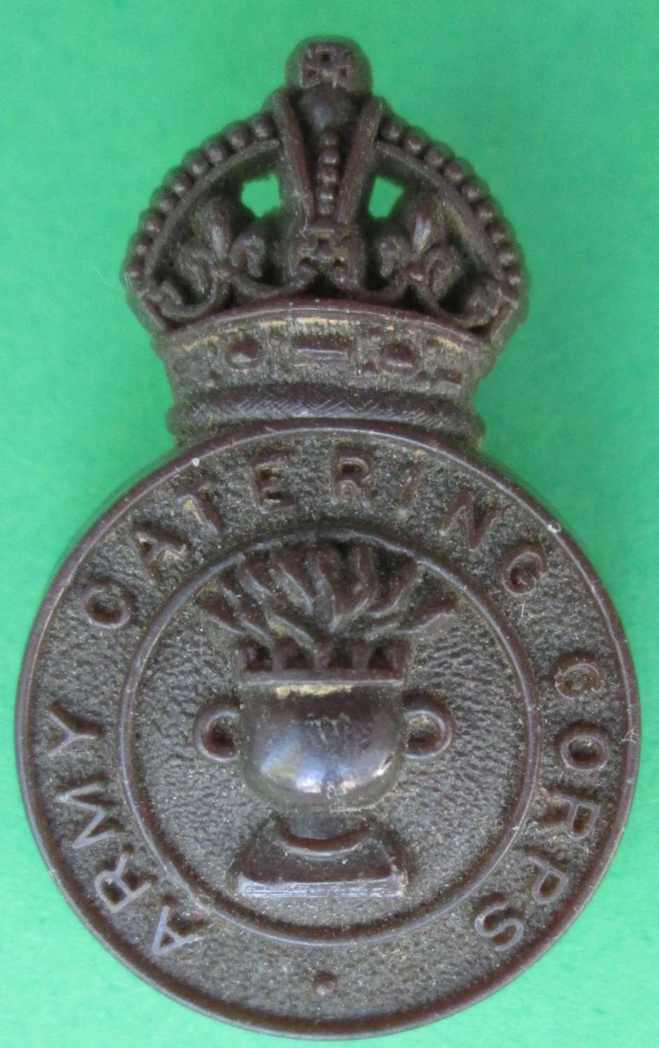 A PLASTIC ARMY CATERING CORPS BADGE
