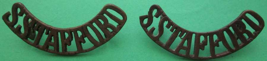 A PAIR OF STAFFORDSHIRE SHOULDER TITLES
