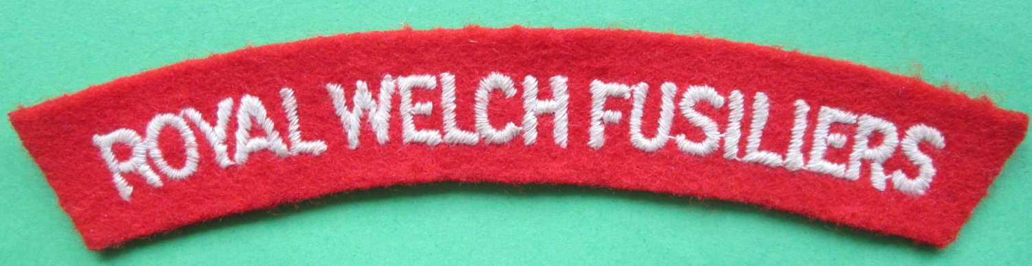A WWII PASTE BACKED ROYAL WELCH FUSILIERS SHOULDER TITLE