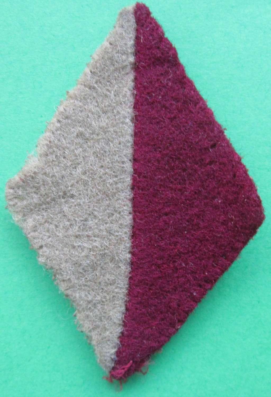 A CHESHIRE REGIMENT DIAMOND FLASH CERISE AND BUFF