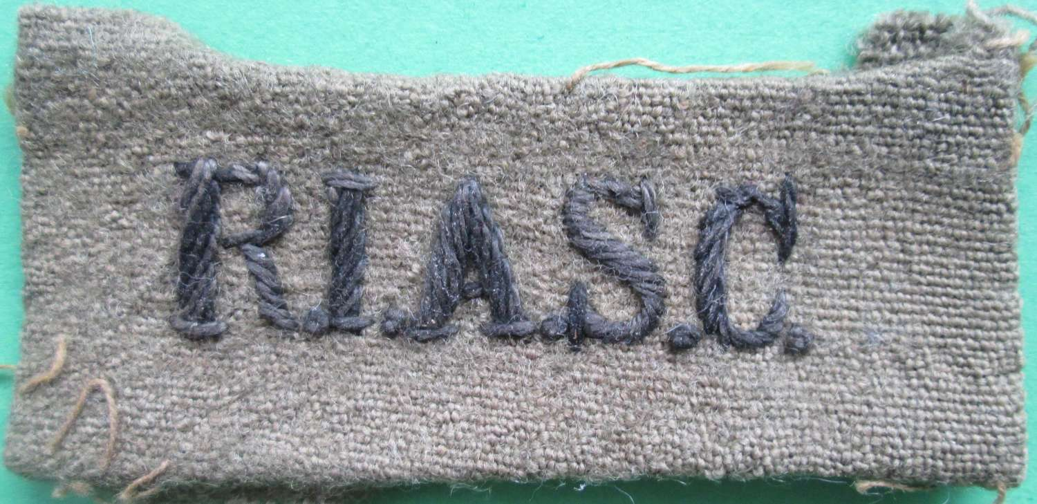 A ROYAL INDIAN ARMY SERVICE CORPS SLIP ON TITLE