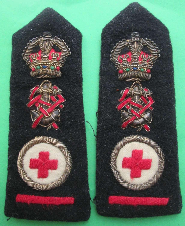 A PAIR OF QA ROYAL NURSING SERVICE SENIOR SISTER SHOULDER BADGES