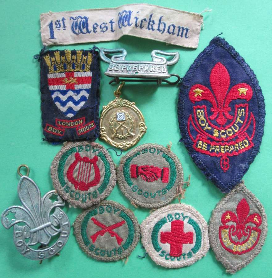 A SELECTION OF SCOUT BADGES