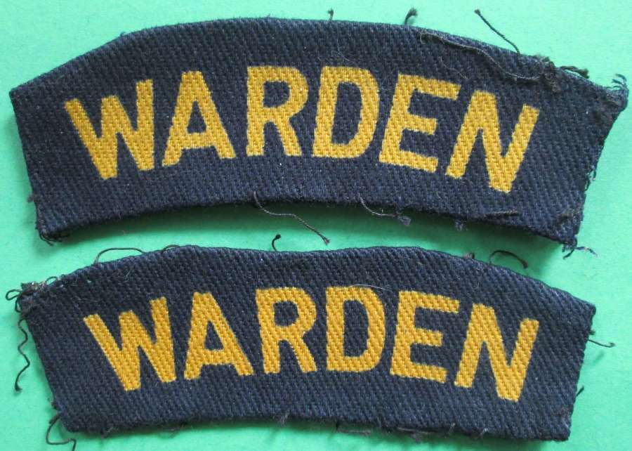 A PAIR OF HOME FRONT WARDEN WWII SHOULDER TITLES