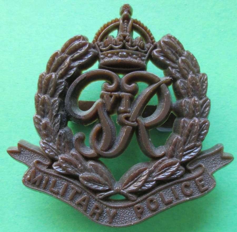 A PLASTIC MILITARY POLICE CAP BADGE