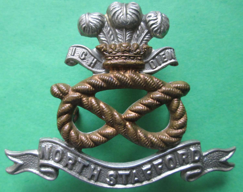 A NORTH STAFFORD REGIMENT CAP BADGE