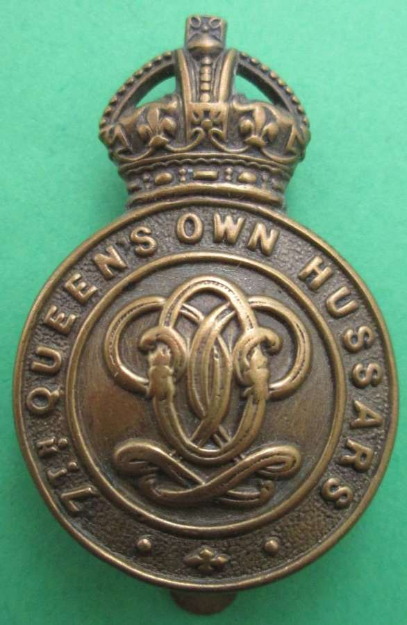 A 7TH QUEEN'S OWN HUSSARS CAP BADGE