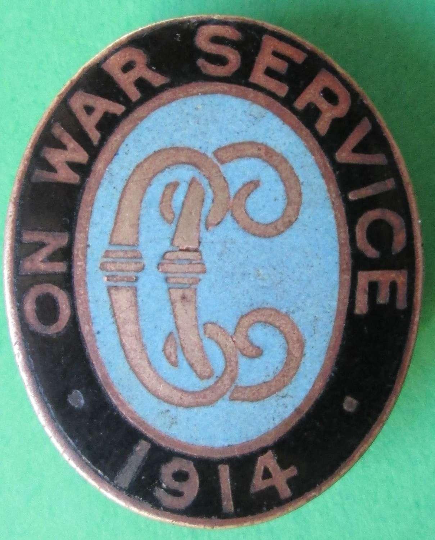 A 1914 ON WAR SERVICE LAPEL BADGE